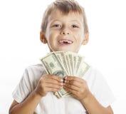 Młoda śliczna chłopiec trzyma udział gotówka, amerykanin Obraz Royalty Free