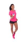 Młoda amerykanina afrykańskiego pochodzenia jogger kobieta trzyma bidon, isol obrazy stock