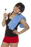 Młoda Azjatycka kobieta z butelką woda Obrazy Stock