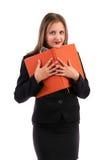 Młoda biznesowa kobieta trzyma jej agendę Fotografia Stock