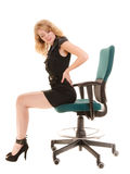 Młoda biznesowa kobieta z backache bólem pleców obrazy stock