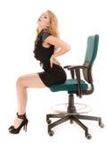 Młoda biznesowa kobieta z backache bólem pleców obraz stock