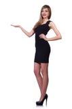 Młoda blond dziewczyna w czerni sukni mieniu odizolowywającym Fotografia Stock
