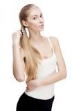Młoda blond kobiety mienia grępla odizolowywająca na bielu Fotografia Stock