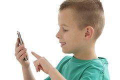 Młoda chłopiec bawić się na komórce Fotografia Stock