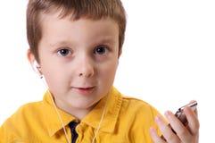 Chłopiec słucha muzyka zdjęcia stock