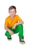 Młoda chłopiec w żółtej koszula Obrazy Royalty Free