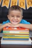 Młoda chłopiec w sala lekcyjnej Zdjęcia Stock