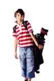 Młoda chłopiec z golfową torbą, odosobnioną zdjęcie stock