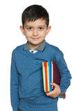Młoda chłopiec z książkami Fotografia Stock