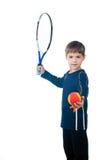 Młoda chłopiec z tenisowym kantem i piłką Obrazy Royalty Free