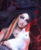Młoda dama z kotem. Zdjęcia Royalty Free