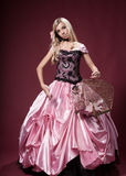 Młoda dziewczyna lubi Barbie lalę Obraz Royalty Free