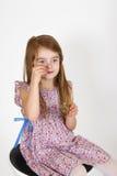 Młoda dziewczyna na krześle Fotografia Stock