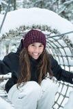 Młoda dziewczyna ono uśmiecha się przy zimą Fotografia Stock