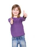 Młoda dziewczyna pokazuje zatwierdzenie z aprobatami obraz stock