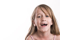 Młoda dziewczyna robi śmiesznym, niemądrym twarzom, Fotografia Stock