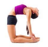 Młoda dziewczyna robi gimnastycznym ćwiczeniom Zdjęcia Stock
