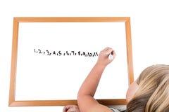 Młoda dziewczyna rysunek na suchym wymazuje deskę Fotografia Royalty Free