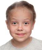 Młoda dziewczyna szczwany uśmiech Fotografia Stock