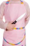 Młoda dziewczyna trzyma kuchennego nóż Zdjęcia Royalty Free