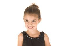 Młoda dziewczyna uśmiecha się przyglądającego oddalonego f w czarnym leotard Fotografia Stock