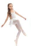 Młoda dziewczyna w jej tana dojechania odzieżowym puszku dotykać jej stopę Zdjęcie Royalty Free