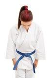 Młoda dziewczyna w kimonowym kłonieniu zdjęcie royalty free