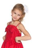 Młoda dziewczyna w mody czerwieni sukni obrazy royalty free