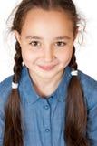 Młoda dziewczyna z długimi pigtails Zdjęcia Stock