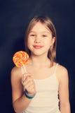 Młoda dziewczyna z lizakiem Zdjęcie Stock