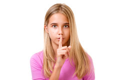 Młoda dziewczyna z palcem na wargach jako pojęcie rozkazuje cisza Ja Obraz Stock
