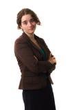 Młoda fachowa kobieta krzyżująca zbroi pracownianego białego tło Obraz Stock