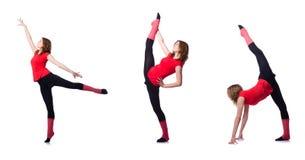 Młoda gimnastyczka ćwiczy na bielu Obrazy Royalty Free