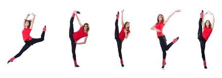 Młoda gimnastyczka ćwiczy na bielu Obrazy Stock