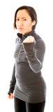 Młoda gniewna kobieta z pięścią up odizolowywającą na białym tle zdjęcie stock