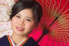 Młoda Japońska dziewczyna w kimonie Zdjęcie Stock