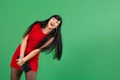 Młoda kobieta jest ubranym czerwieni suknię z emocjami Zdjęcie Royalty Free