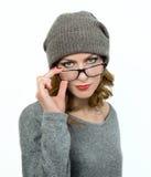 Młoda kobieta jest ubranym jej szkła Zdjęcia Stock