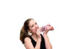 Młoda kobieta kąsek kawałek mięso Zdjęcia Stock