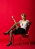 Młoda kobieta nauczyciel w białej bluzce i czarnej spódnicie Zdjęcia Stock