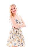 Młoda kobieta ono uśmiecha się z jej rękami krzyżować obrazy stock
