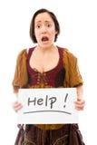 Młoda kobieta patrzeje okaleczający i pokazuje pomoc znaka na białym backgr zdjęcie royalty free