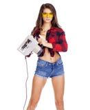 Młoda kobieta pokazuje budów narzędzia Fotografia Stock