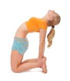 Młoda kobieta robi gimnastycznym ćwiczeniom Obraz Royalty Free