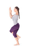 Młoda kobieta robi joga ćwiczenia Garudasana orła pozie obrazy royalty free