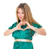 młoda kobieta robi sercu Fotografia Royalty Free