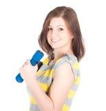 Młoda kobieta robi sprawności fizycznych ćwiczeniom odizolowywającym na białym tle Obrazy Royalty Free