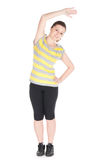 Młoda kobieta robi sprawności fizycznych ćwiczeniom odizolowywającym na białym tle Zdjęcie Royalty Free