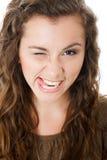 Młoda kobieta robi twarzom Fotografia Stock